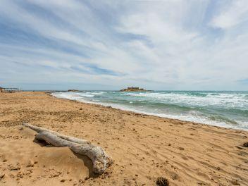 Playa Carratois e, sullo sfondo, Isola delle Correnti
